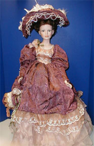 Porcelain Doll with Mauve Dress
